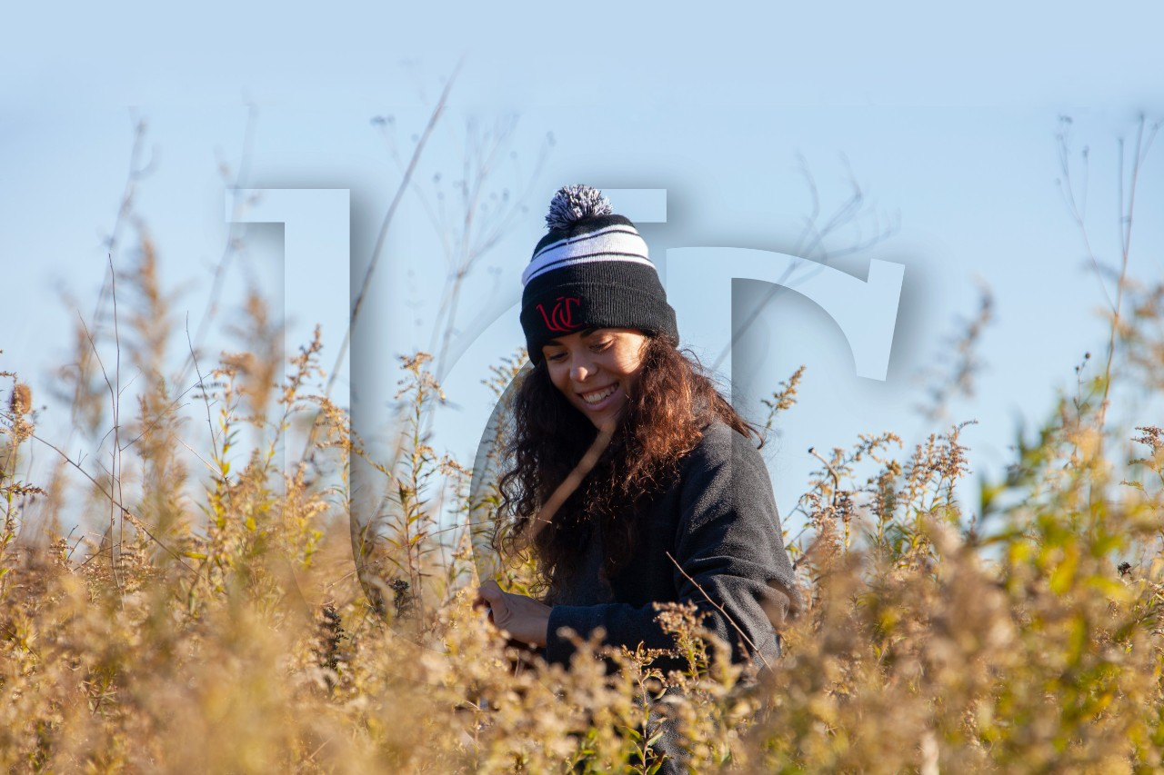 A UC Undergrad Botany student conducts field research